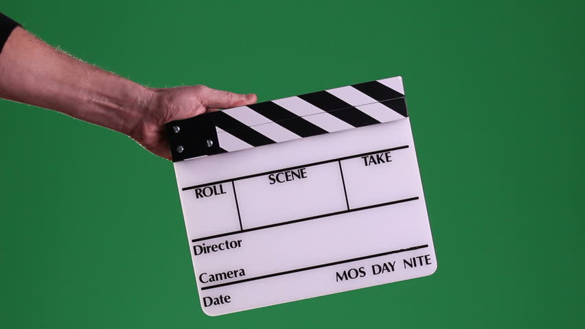 A motion picture clapboard, also called a slate, with hands snapping the stick on a green screen background