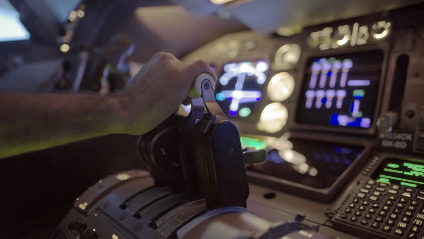 Detail shot of airline pilot pushing throttle forward and then pulling back in the cockpit of a jumbo jet.  Side view, hand-held camera, originally recorded in 4K. | Shutterstock HD Video #11155154