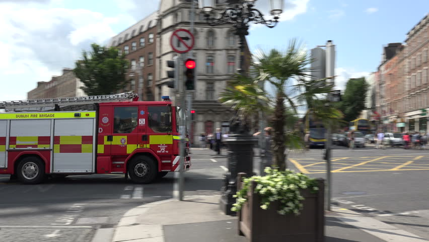 DUBLIN, LEINSTER/IRELAND - JULY 15, 2015: Emergency fire engine turns onto Oconnell Bridge in the city centre. There are currently 14 fire stations manned by DFB.