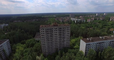 Aerial drone footage. The Abandoned City of Pripyat near Chernobyl. Once a beautiful town by Soviet standards, its 50,000 inhabitants were evacuated 36 hours after the accident. 4K.