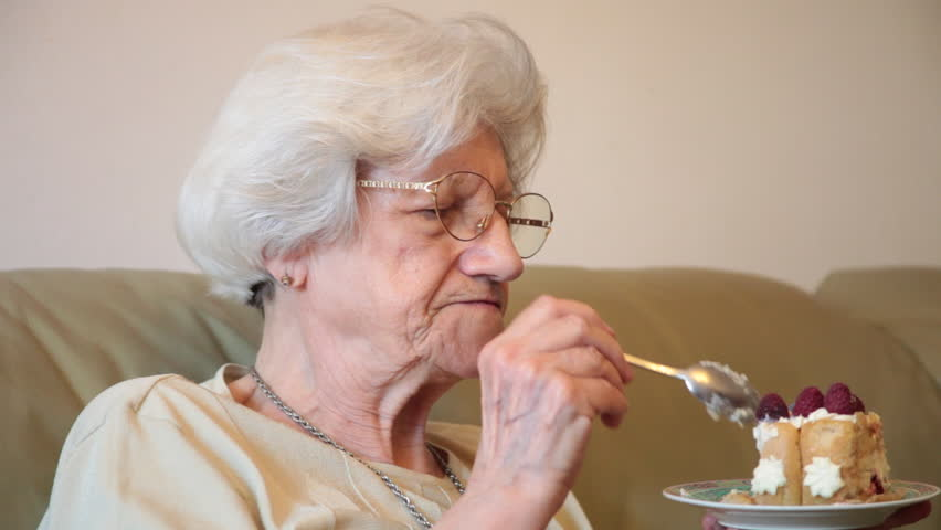 Elderly Woman Eating Tasty Birthday Cake At Home Royalty Free Video