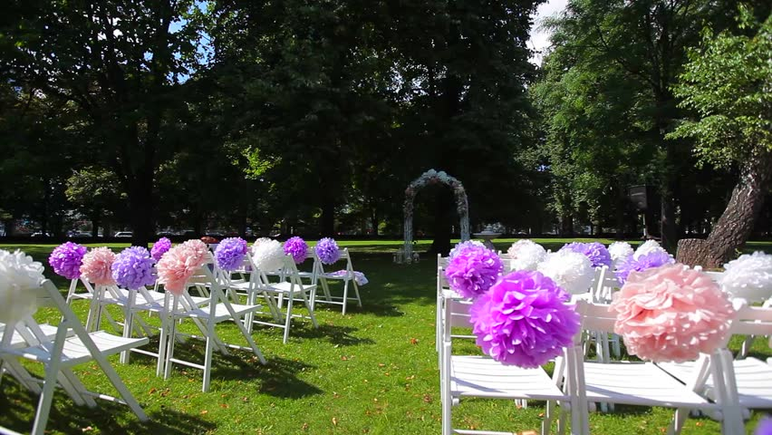 Wedding Ceremony In The Park Decorations Chairs With Colored Bows Stock Footage Video 11183939