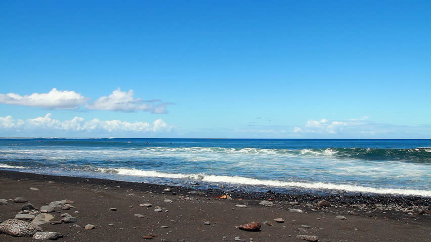 Waves on black sand beach, Tahiti island, Polynesia.