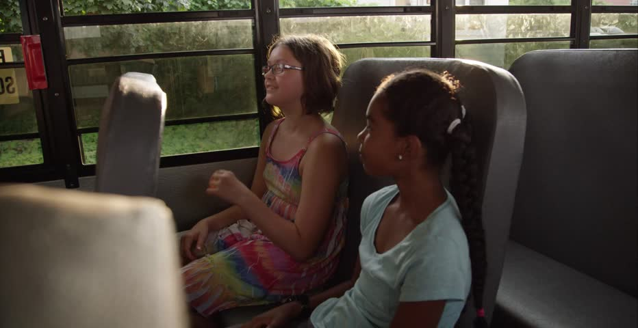 Young kids flirting on the school bus | Shutterstock HD Video #11235419