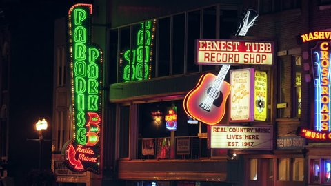 NASHVILLE - AUGUST 13: Neon signs of the Honky-tonks and other tourist attractions light up Broadway in The District on August 13, 2015 in Nashville, Tennessee.