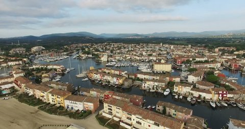 2015 High Quality Aerial Video (Ultra HD) of Port Grimaud in the French Riviera near St. Tropez. Also known as 'Venice in France' because of the many canals and boats. Camera moving left.