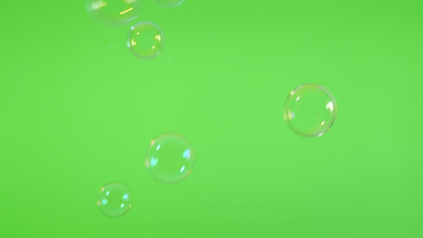 Transparent soap bubbles in front of green screen display slow flowing 4K 2160p UHD footage - Bubbles blown from soap foam falling in front of greenscreen display 4K 3840X2160 30fps UltraHD video