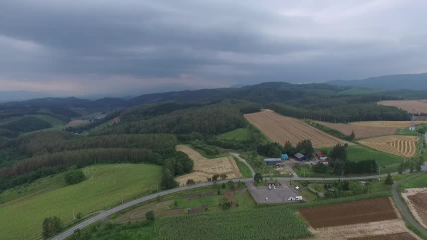 Vast green hills of the landscape that were transferred empty drone. _3 / August 18, 2015 in Japan of the shooting in Hokkaido / Hill landscape undulating green that spread to the plains beautiful.   Shutterstock HD Video #11273879