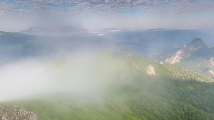 Time lapse. Russia, the Caucasus Mountains, Adygea.  Fog over the forest in the mountains. | Shutterstock HD Video #11287379