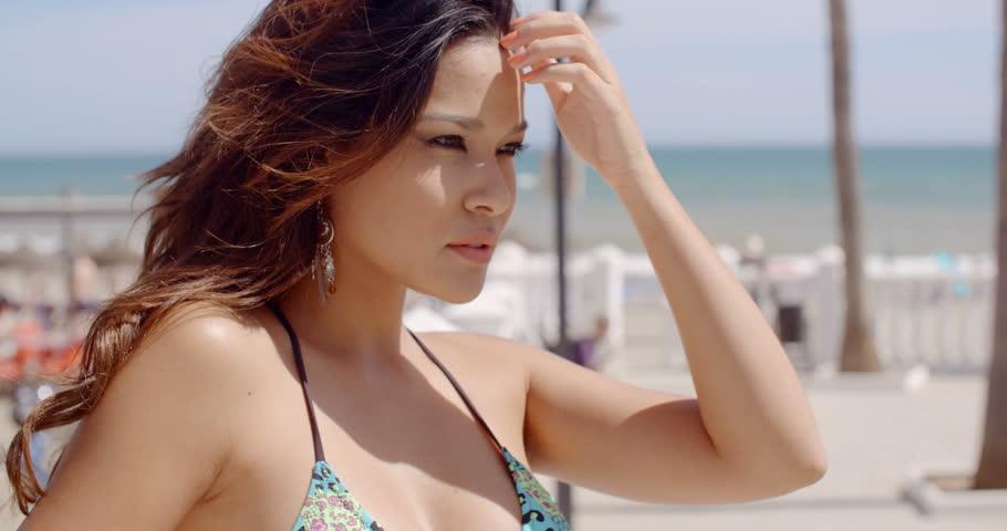 118b1254d7 Beautiful Girl in Bikini Posing Stock Footage Video (100% Royalty ...
