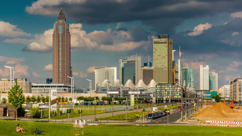 FRANKFURT AM MAIN, GERMANY - AUG 7, 2014: Hyperlapse video of Frankfurt skyline with bank and Trade Fair buildings, Germany.