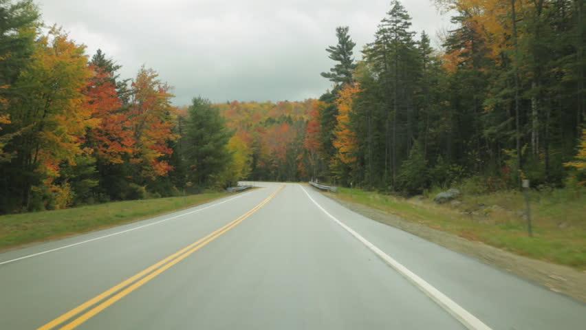 Driving on the Kancamagus Highway in the White Mountains of New Hampshire in Autumn.