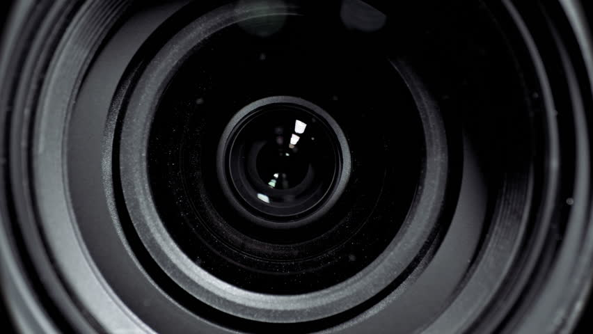 Camera lens zoom. Changing focal length. Front view macro shot.