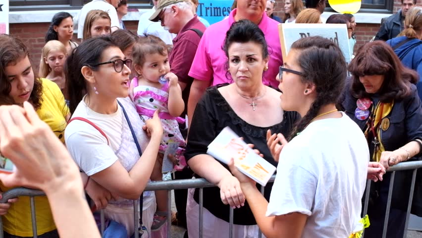 NEW YORK CITY - AUGUST 22 2015: a coalition of right to life activists gathered in front of Planned Parenthood to protest while pro-choice counterprotesters also appeared & debated the issues