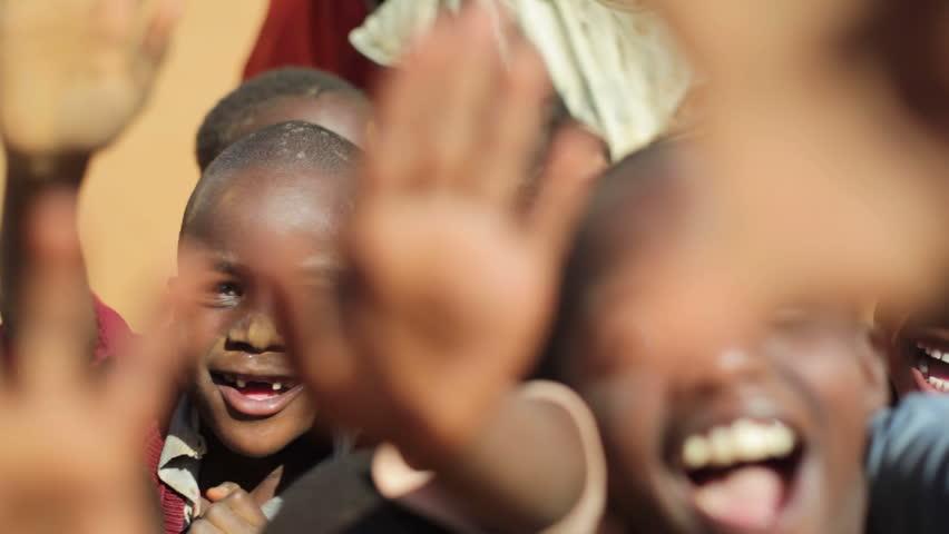 KENYA - CIRCA JULY 2013 - Children wave hello in Samburu, Kenya, Africa