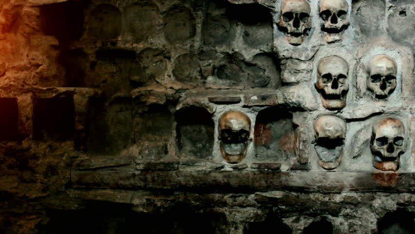 Human skull in the wall;Human skull built into the stone wall,  video clip with light effects