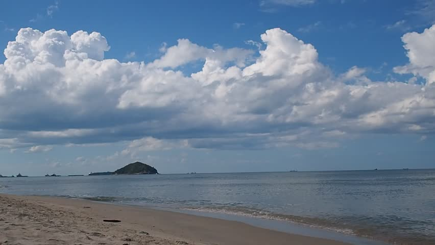Beautiful white clouds and sea waves on the tropical beach on a cloudy day with blue sky. Samila beach at Songkhla, South of Thailand | Shutterstock HD Video #11356679