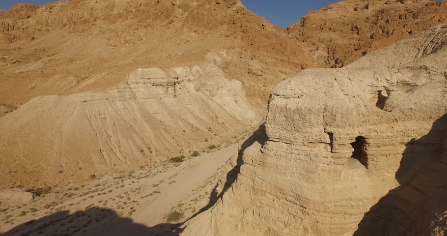 Soaring 4K aerial view above the Dead Sea Scroll caves in QUMRAN, ISRAEL. Filmed with permission.