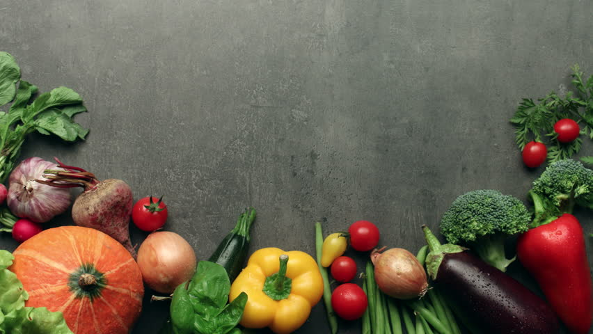 Kitchen Table With Food moving vegetables on kitchen table, harvest background - stop