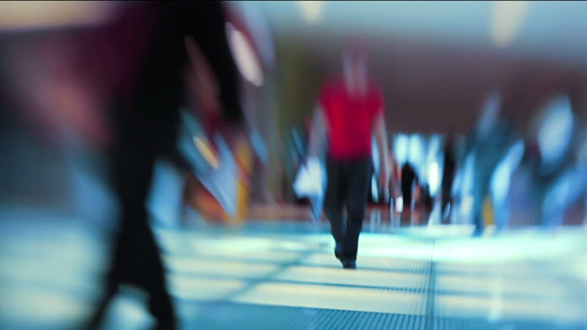Defocused crowd in shopping mall. Blurred motion.