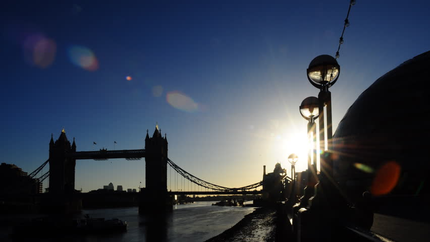 Early Morning Sunrise Time Lapse Behind The Famous Tower Bridge Over River Thames In London England Sun Moves Lights On Embankment And
