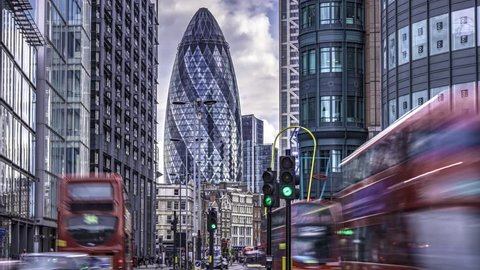 LONDON, UK - JULY 14: Timelapse view of a busy crossroad in the hearth of the financial district of the City of London, near Liverpool street train station, London, UK. July 14, 2015