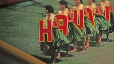 HAWAII 1976: Hawaii sign grass skirt hula dancers show off to crowds.