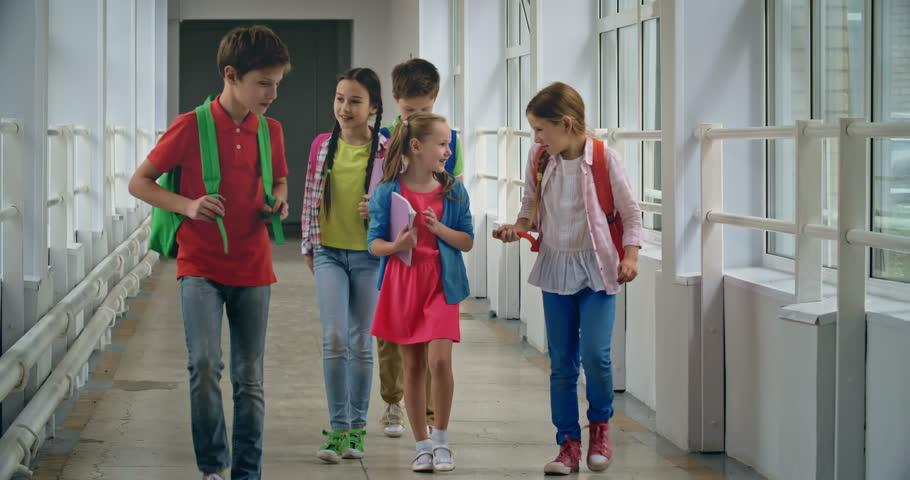 Excited Pupils Running Down School Corridor Towards Camera ...