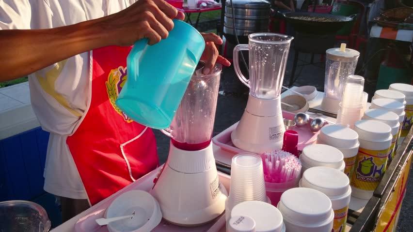 """Ice Cream Vendor Prepares Ice Blended Drink At """"Pasar Malam"""" or night market at Subang Jaya, Malaysia"""