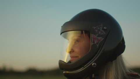 Smiling Girl Skydiver is Taking off the Helmet after Successful Landing. Shot on RED Cinema Camera in 4K (UHD).