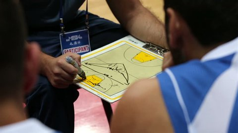 """MOSCOW, RUSSIA - SEPTEMBER 01, 2015: Coach explains the strategy of the game before the match. Basketball game during the Second International Festival of Students  Sports """"Moscow Games 2015""""."""