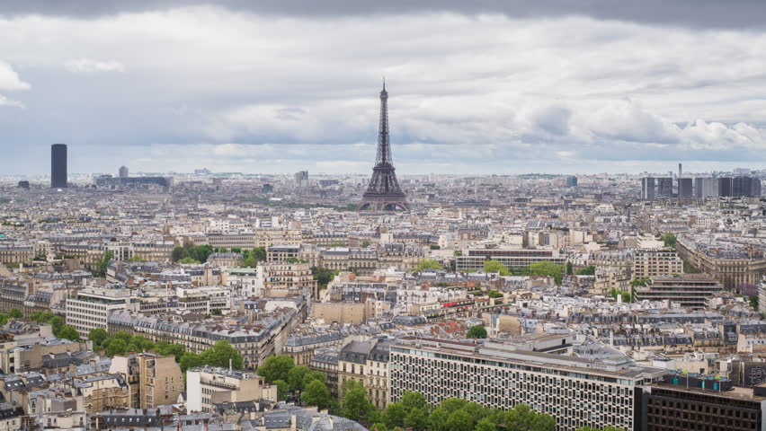 Eiffel Tower, elevated aerial view over rooftops, CIRCA 2015- Paris, France - timelapse | Shutterstock HD Video #11605559