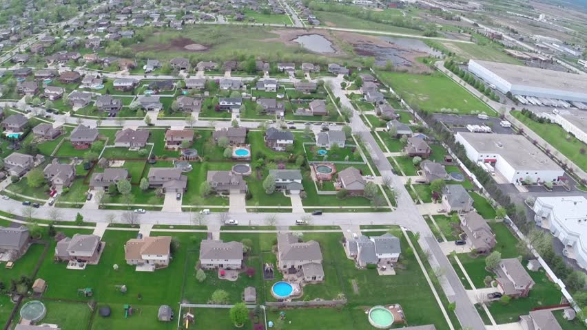 Flying Over Residential Houses And Yards Along Suburban Street