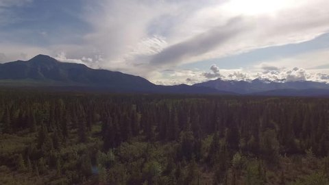 Aerial landscape in North America. Aerial road in the forest. Beautiful range mountains. Rocky Mountains in Yukon.
