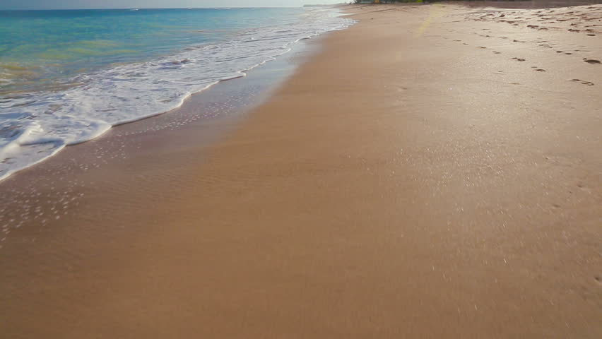Ocean Scenic Landscape. Waves Rolling and Crashing on White Sandy Beach. Incoming Swell Gently Washes on Shoreline in Maui
