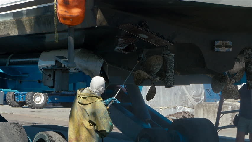 Boat hull being pressure washed 44 foot boat on lift, Tacoma, WA 2015 -