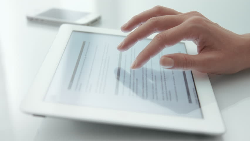 Business people using a tablets. Dolly. 3 videos in 1. More options in my portfolio. | Shutterstock HD Video #11728739