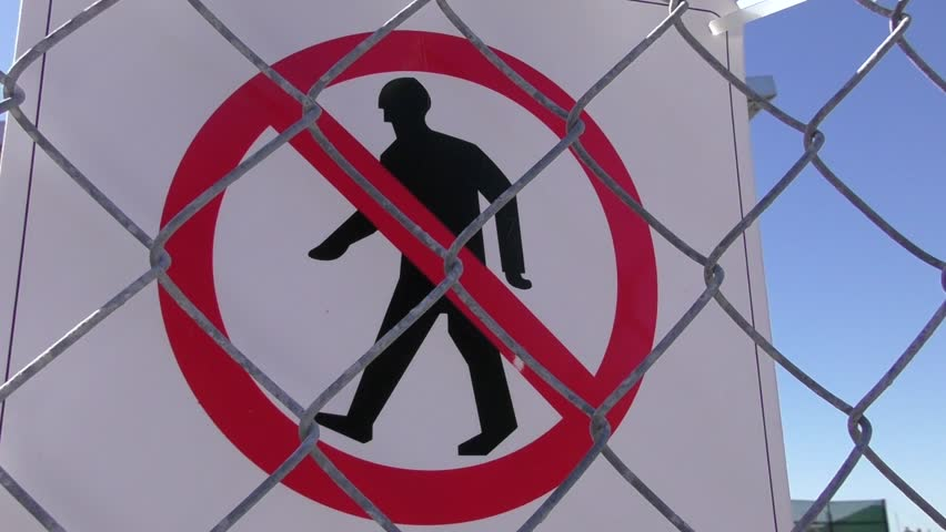 No entry and trespassing sign on property security fence windy outdoors. - HD stock video