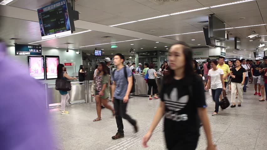 Singapore, Singapore/Singapore - July 18 2015: Busy People in MRT (Mass Rapid Transit) Airport Singapore in South East Asia