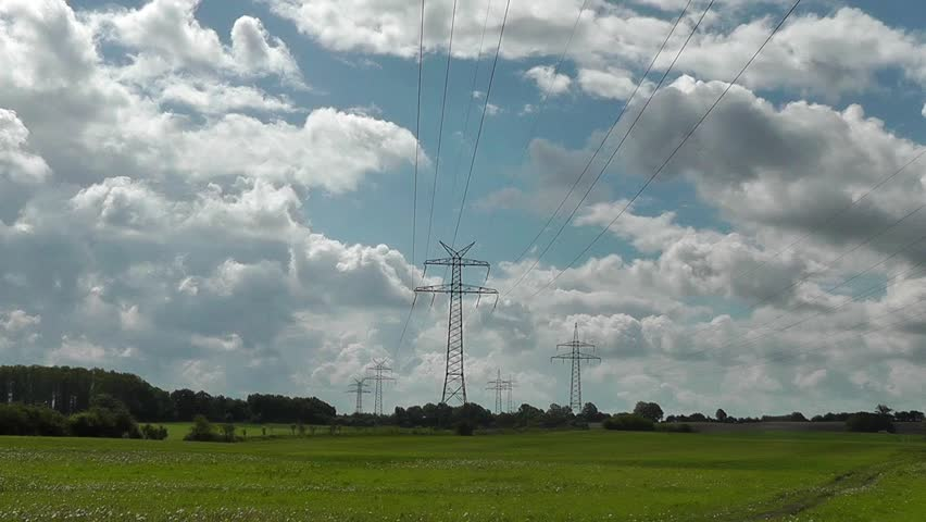 High Voltage Lines and Clouds - Time Lapse