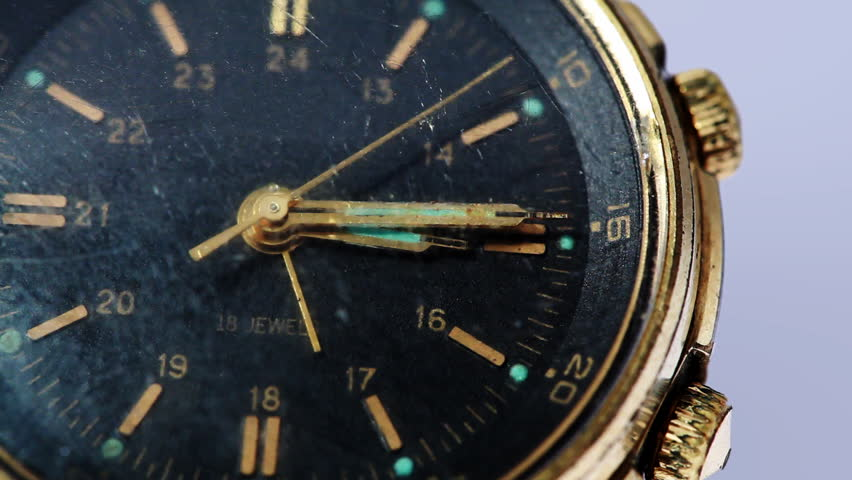 antique gold wristwatch with moving second hand, closeup