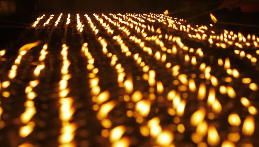 Buddhist candle in temple during Kalachakra festival. Mahabodhi Temple in Bodhgaya, Bihar, India.