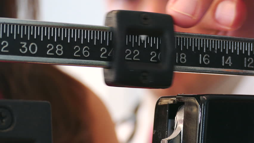 4K: Exam: Doctor Adjusts Scale To Find Patient's WeightShot in 4K on the Lumix FZ1000.