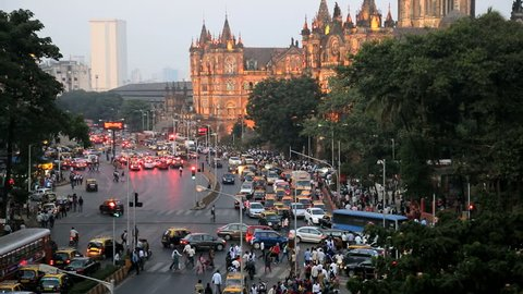 India - March 2015: Mumbai India Asia Chhatrapati Shivaji Terminus Victoria Terminus Maharashtra State CST sunset illuminated railway travel