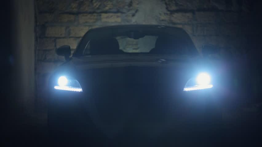 Turn on the headlights of car in a dark stone garage   Shutterstock HD Video #11950751