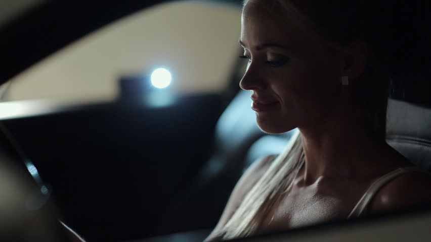 Sexy blonde at the wheel of the cool car