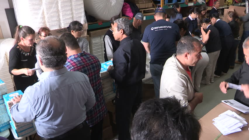 Toronto, Ontario, Canada September 2015 Workers in Toronto Canada packaging aid supplies for refugees from war in Syria and middle east