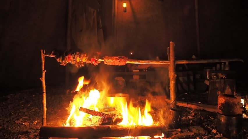 Roasting meat on a wooden pole over a c&fire inside a tipi lit by oil l&s & Inside Tent Stock Footage Video | Shutterstock