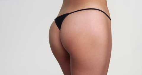 Rear view closeup of attractive woman wearing thong