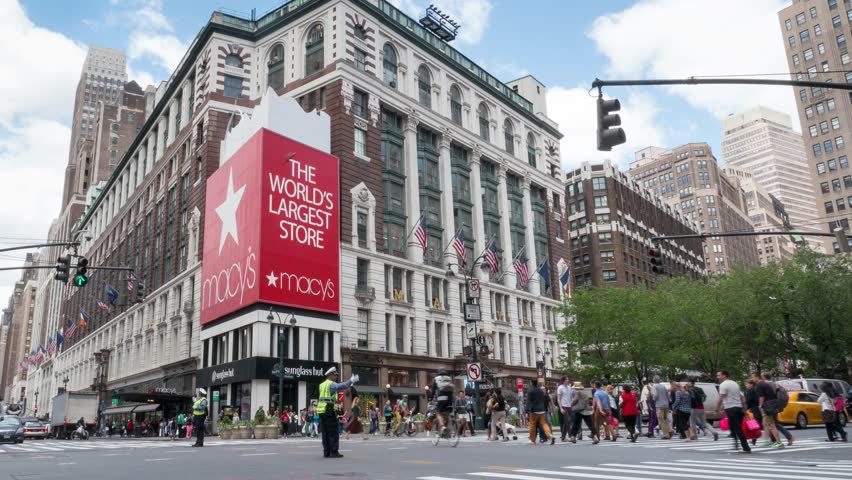 NEW YORK CITY - MAY 13, 2015: Historic Macy's Herald Square at 34th Street. Macy's is a mid-range chain of department stores owned by American multinational corporation Macy's, Inc. Time lapse video.